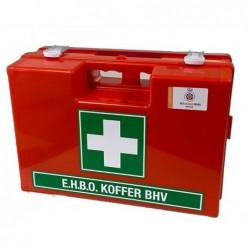 Oranje verbandkoffer met groene sticker en wit kruis